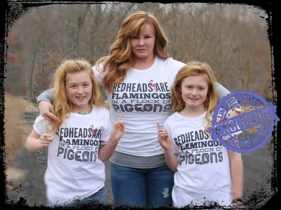 Redheads are flamingos in a flock of pigeons shirt